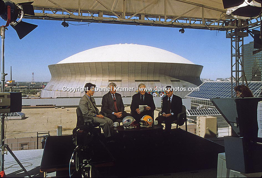 On the set of ESPN's Sports Reporters on location in New Orleans for Super Bowl XXXI. From left: Mitch Albom, Bob Ryan, Dick Schaap and Mike Lupica.