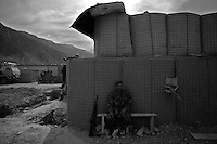 An Afghan soldier waits to go on a mission at Forward Operating Base Bostick in Northern Kunar Province, Afghanistan on Thursday March 25 2010..Afghan soldiers are from 1st Coi ( Company ), 1st Kandak ( battalion ) 2nd Brigade.