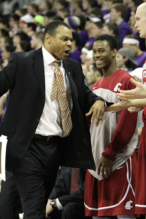 Ben Johnson, Washington State assistant coach, has high-fives for everyone near the end of the Cougars 80-69 road victory over arch-rival Washington at the Alaska Airlines Arena in Seattle, Washington, on February 27, 2011.  With the victory, the Cougars swept the regular season series from the Huskies, two games to none.