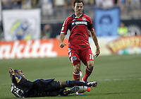 CHESTER, PA - AUGUST 12, 2012:  Amobi Okugo (14) of the Philadelphia Union slides the ball away from  Marco Pappa (16) of the Chicago Fire during an MLS match at PPL Park, in Chester, PA on August 12. Fire won 3-1.