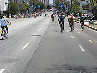 During CicLAvia on June 23, 2013 6 miles of Wishire Blvd. were entirely closed to cars and motorized vehicles.  The street was filled with thousands upon thousands of bicyclists, pedestrians, roller skaters, roller bladers, skate boarders and scooters!  Taken just west of Wilshire Part & Wilton looking east towards downtown LA.