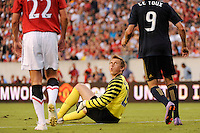 Manchester United goalkeeper Tomasz Kuszczak (29) looks up at Sebastien Le Toux (9) of the Philadelphia Union after making a save off his header during an international friendly between Manchester United (EPL) and the Philadelphia Union (MLS) at Lincoln Financial Field in Philadelphia, PA, on July 21, 2010.