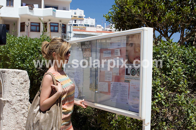 **ALL ROUND PICTURES FROM SOLARPIX.COM**.**WORLDWIDE SYNDICATION RIGHTS**.TV presenter Kate Garraway looking at a Maddie missing poster in Praia da Luz in Portugal today.JOB REF:   6299       AB1        DATE:01.05.08.**MUST CREDIT SOLARPIX.COM OR DOUBLE FEE WILL BE CHARGED* *UNDER NO CIRCUMSTANCES IS THIS IMAGE TO BE REPRODUCED FOR ANY ONLINE EDITION WITHOUT PRIOR PERMISSION*