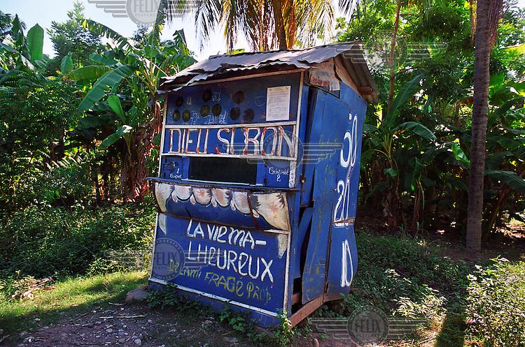 'La vie malheureux' - 'Unhappy life'. A tiny bingo shop near Port de Paix.