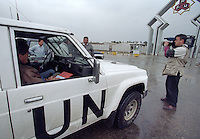 Media watch as  <br /> UN weapons inspectors arrive at an industrial site in February 1998 to look for WMDs (weapons of mass destruction). The UNSCOM weapons inspectors left Iraq later that year.<br /> <br /> <br /> <br /> ©Fredrik Naumann/Felix Features