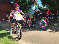 NWA Democrat-Gazette/SPENCER TIREY Camryn Hodge (8) gets ready to rides her bike as she participates Wednesday, July 4, 2018, with other from her neighborhood in a 4th of July parade on Turtle Creek Drive in Rogers. Camryn who organized the event said she organized it because she wanted to show how much she loved America and wanted to make new friends.