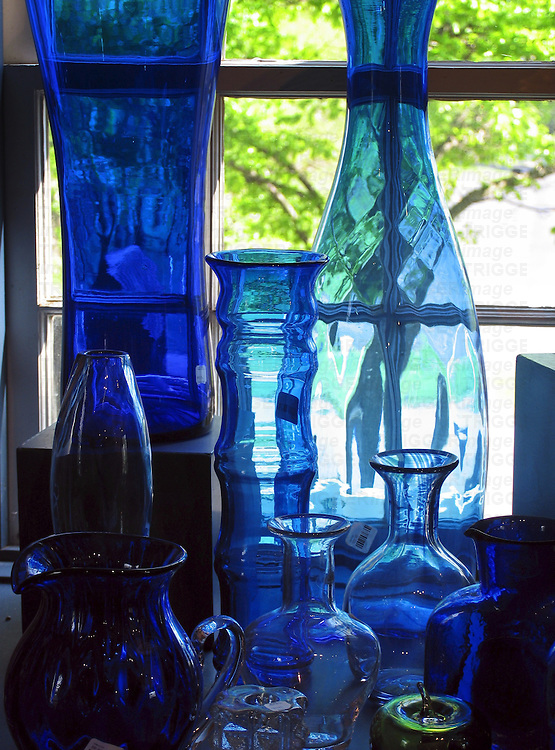 Blue glass bottles on a window sill