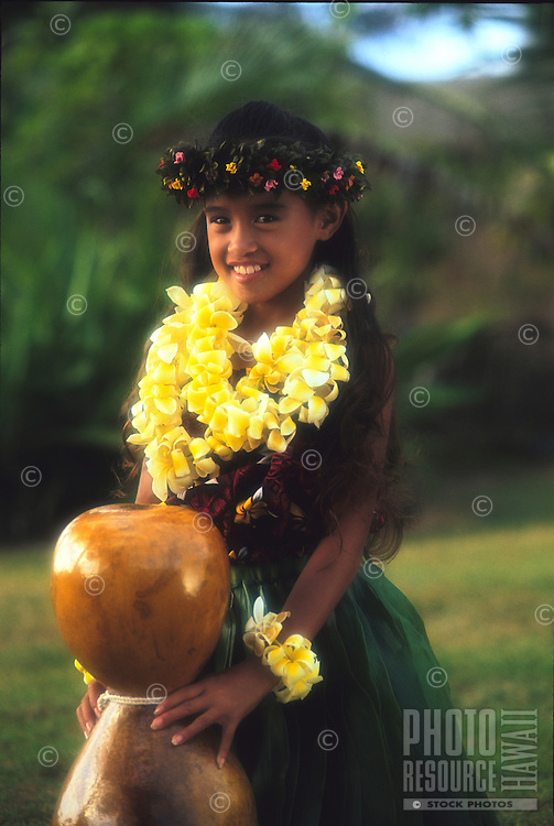 Young hula dancer (Korie Ann) with an Ipu Heke