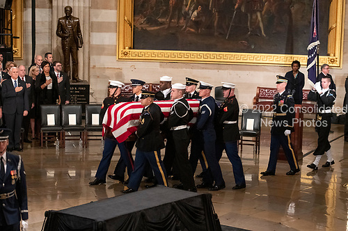 A military honor guard carries the casket containing the remains of former United States President George H.W. Bush into the Rotunda of the US Capitol at the ceremony honoring the former President who will Lie in State in the Rotunda of the US Capitol on Monday, December 3, 2018.<br /> Credit: Ron Sachs / CNP<br /> (RESTRICTION: NO New York or New Jersey Newspapers or newspapers within a 75 mile radius of New York City)