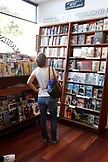 USA, California, San Francisco, a woman browses books at City Lights Bookstore, North Beach