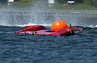Regates de Valleyfield, 6-8 July,2001 Salaberry de Valleyfield, Quebec, Canada.Copyright©F.Peirce Williams 2001.Frame 5: CE-222, 5 Litre class hydroplane, races into turn two hops once and hooks to the left, digs in with the left side and flips over. With help from the rescue team the driver climbs out trough the bottom hatch unhurt...F. Peirce Williams .photography.P.O.Box 455  Eaton, OH 45320.p: 317.358.7326  e: fpwp@mac.com