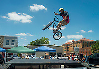 NWA Democrat-Gazette/BEN GOFF @NWABENGOFF<br /> Raven Mendoza of Fayetteville jumps Saturday, July 7, 2018, at a Southern BMX Stunt Show performance during The Natural State Criterium Series in downtown Rogers. The third annual series produced by BikeNWA began with races in downtown Bentonville Friday evening. The series concludes Sunday in downtown Springdale with the first event starting at 8:50 a.m. and the final event starting at 4:00 p.m.