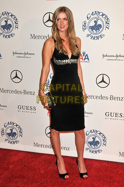 NICKY HILTON.The 30th Annual Carousel Of Hope Ball at the Beverly Hilton Hotel, Beverly Hills, California, USA..October 25th, 2008.full length black dress clutch bag .CAP/ADM/BP.©Byron Purvis/AdMedia/Capital Pictures.