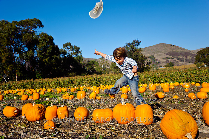Playing in the pumkin patch, San Luis Obispo, California