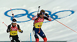 2/21/06 -- The 2006 Torino Winter Olympics -- Cesana San Sicario , Italy. -- 4 X 7.5 km biathlon -- .FOR GNS..The USA's Lowell Bailey races past the olympic rings followed by Japan's Kyoji Suga during the men's 4x7.5 Kilometer Biathlon Relay in San Sicario, Italy..Photo by Scott Sady, USA TODAY staff..