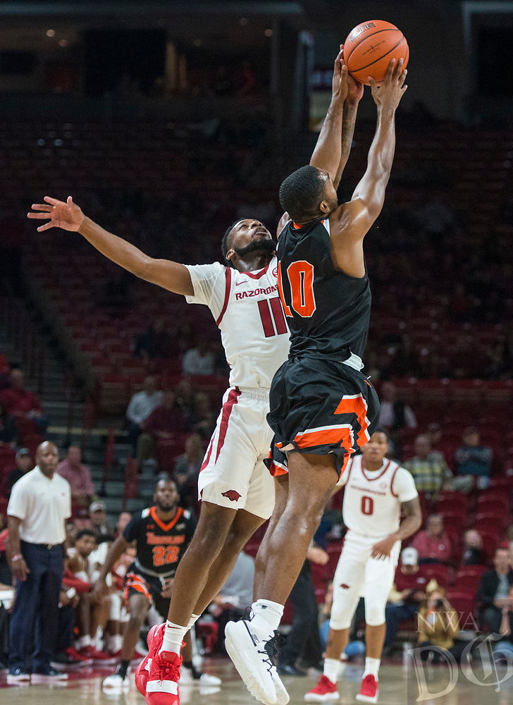 NWA Democrat-Gazette/BEN GOFF @NWABENGOFF <br /> Keyshawn Embery-Simpson (11) of Arkansas steals the ball from Myles Jones of Tusculum in the first half Friday, Oct. 26, 2018, during an exhibition game in Bud Walton Arena in Fayetteville.
