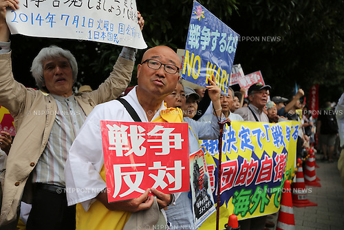 July 1, 2014, Tokyo, Japan - Carrying placards and banners, thousands of protesters gather outside Japanese Prime Minister Shinzo Abe's official residence in downtown Tokyo to show their opposition to Abe's collective self defense on Tuesday, July 1, 2014. Abe's Cabinet approved collective self-dense despite the large number of citizens opposing the policy. Under the new rule, Japan's military would be allowed Japan to defend friendly nations in the event of an attack. (Photo by AFLO)