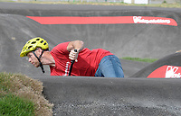 NWA Democrat-Gazette/DAVID GOTTSCHALK Race director Joost Wichman, of the Netherlands, takes a practice run Tuesday, October 9, 2018, on the pump track at the Runway Bicycle Skills Park at the Jones Center in Springdale. The park will host the Pump Track (bicycling) World Championships sponsored by Red Bull on Saturday, October 13. A pump track is designed so that bikers pump and push on hills and turns to build speed using their upper body and hips instead of pedaling.