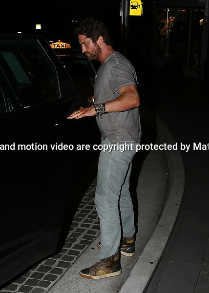 8 MARCH 2014 SYDNEY AUSTRALIA<br /> <br /> EXCLUSIVE PICTURES<br /> <br /> Gerard Butler pictured leaving The Royal Hotel at Five Ways Paddington after a few beers with some friends and a mystery blonde - the party continued to The Ivy <br /> <br />  <br /> *No internet without clearance*.MUST CALL PRIOR TO USE +61 2 9211-1088. Matrix Media Group.Note: All editorial images subject to the following: For editorial use only. Additional clearance required for commercial, wireless, internet or promotional use.Images may not be altered or modified. Matrix Media Group makes no representations or warranties regarding names, trademarks or logos appearing in the images.