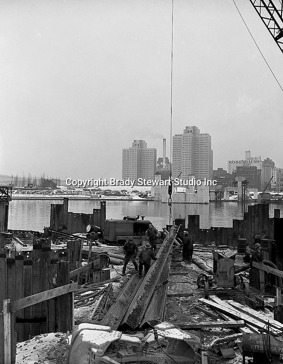 Pittsburgh PA:  View of Gateway Center from the South Side construction site for the Fort Pitt Bridge and Tunnels - 1958