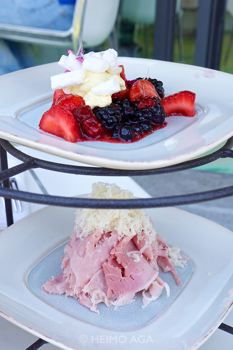 Vienna, Austria. Steirereck breakfast at the Meierei im Stadtpark.<br /> Marinierte Beeren mit Baiser &amp; Passionsfrucht (Marinated Berries with Meringue and Passionfruit) and Beinschinken mit Kren &amp; Weizenknusper (Gammon Ham with Fresh Horseradish &amp; Panini)