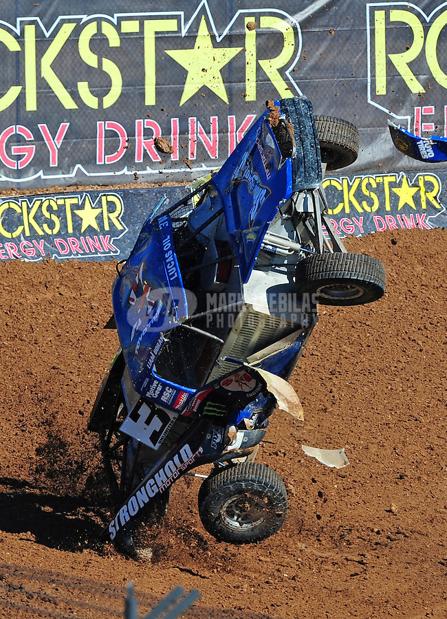 Dec. 9, 2011; Chandler, AZ, USA;  LOORRS pro four unlimited Liam Doran crashes and flips during qualifying for round 15 at Firebird International Raceway. Mandatory Credit: Mark J. Rebilas-