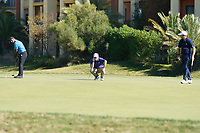 Jordan Smith (ENG) George Coetzee (RSA) and Shubhankar Sharma (IND) on the 8th green during Round 1 of the Portugal Masters, Dom Pedro Victoria Golf Course, Vilamoura, Vilamoura, Portugal, 24/10/2019<br /> Picture Andy Crook / Golffile.ie<br /> <br /> All photo usage must carry mandatory copyright credit (© Golffile | Andy Crook)