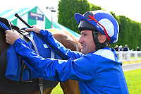 Jockey Dane O'Neil unsaddles Tamreer in the winners enclosure after winning The Smith & Williamson Fillies' Novice Stakes (Class 5))  during Afternoon Racing at Salisbury Racecourse on 17th May 2018