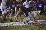 The University of Kentucky's Christian Student Fellowship broke the world record for the world's largest water balloon fight once again Friday night at the recreation fields. Photo by Scott Hannigan | Staff