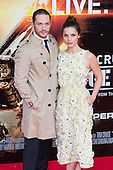 """Husband and wife Tom Hardy with Charlotte Riley. First World Premiere of the new Tom Cruise and Emily Blunt movie """"Edge of Tomorrow"""" at the BFI IMAX cinema in London, United Kingdom. As the film is about reliving the events of one day over and over in an epic battle to save the world, the stars of """"Edge of Tomorrow"""" take part in a worldwide event when, for the first time ever, three fan premieres will be held in three different countries in just one day."""