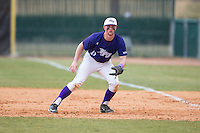High Point Panthers first baseman Spencer Angelis (11) on defense against the UNCG Spartans at Willard Stadium on February 14, 2015 in High Point, North Carolina.  The Panthers defeated the Spartans 12-2.  (Brian Westerholt/Four Seam Images)