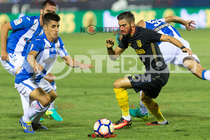 Atletico de Madrid's Yannick Ferreira Carrasco and Club Deportivo Leganes's Unai Bustinza and Martin Mantovani  during the match of La Liga between Club Deportivo Leganes and Atletico de Madrid at Butarque Estadium in Leganes. August 27, 2016. (ALTERPHOTOS/Rodrigo Jimenez) /NORTEPHOTO