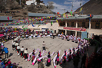 East Village, Diqing Tibetan Autonomous Prefecture, Yunnan Province, China - Tibetan villagers perform traditional Xianzi Dance, February 2017.