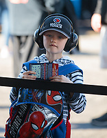 Feb 9, 2019; Pomona, CA, USA; A young NHRA fan waits to get an autograph from top fuel driver Antron Brown (not pictured) during qualifying for the Winternationals at Auto Club Raceway at Pomona. Mandatory Credit: Mark J. Rebilas-USA TODAY Sports