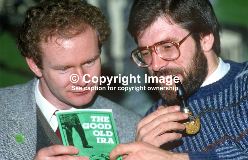 Enjoying a quick read of a book, &quot;The Good Old IRA&quot;, during a break in the proceedings are top Provisional Sinn Fein leaders Martin McGuinness, Londonderry, left, and Gerry Adams, Belfast, at the 1985 Ard Fheis (party political conference) in Dublin. 19851101GA1.<br />