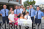 Caherciveen Gardai presenting of a cheque for EUR2000 to Down Syndrome Ireland on Thursday at Tralee Garda Station which was raised from an Ice cream funday last weekend Front Hugh O'Brien, Ava and Emily Kelleher and Simon Pierse..Back from left Kieran Clancy, Patricia Griffin, Chief Supt John Kerin, Lichael O'Donovan, Ristard Pierse, Jill O'Brien, John Keohane, Paul Cogan and Kieran Brennan.