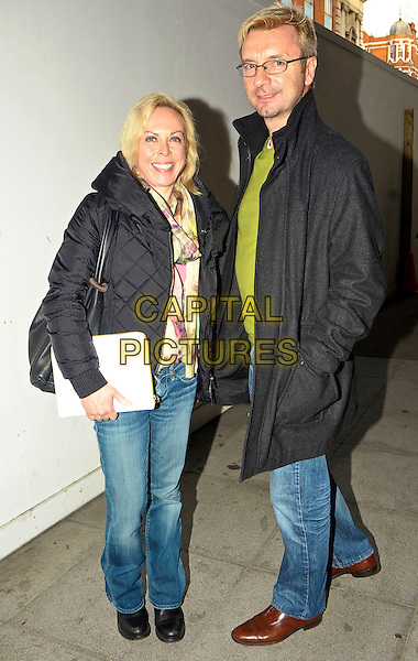 Jayne Torvill and Christopher Dean spotted London, England..November 23rd, 2011.full length black jacket jeans denim green top glasses .CAP/DYL.©Dylan/Capital Pictures.