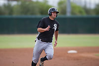 Justin Yurchak (65) of the Chicago White Sox hustles to third base during an Instructional League game against the San Diego Padres on September 26, 2017 at Camelback Ranch in Glendale, Arizona. (Zachary Lucy/Four Seam Images)