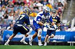FOXBORO, MA - MAY 28: Kevin Reisman (13) of the Limestone Saints races past Blake Boudreau (17) of the Merrimack Warriors during the Division II Men's Lacrosse Championship held at Gillette Stadium on May 28, 2017 in Foxboro, Massachusetts. (Photo by Larry French/NCAA Photos via Getty Images)