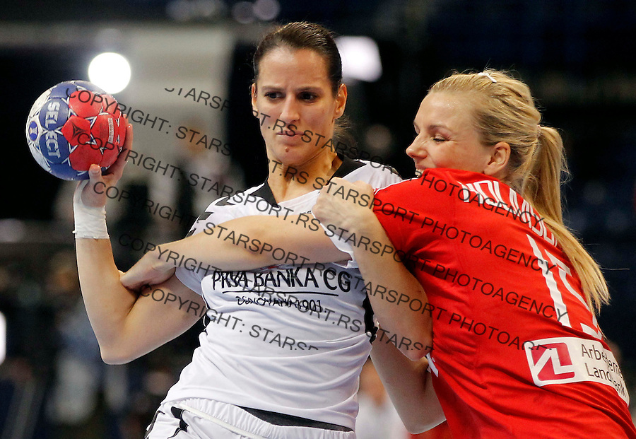 BELGRADE, SERBIA - DECEMBER 15:  Andjela Bulatovic (L) of Montenegro is challenged by  Pernille Holst Holmsgaard (R) of Denmark during the 2013 World Women's Handball Championship 2013 match between Denmark and Montenegro at Kombank Arena Hall on December 15, 2013 in Belgrade, Serbia. (Photo by Srdjan Stevanovic/Getty Images)