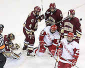 Mike Brennan 4, Anthony Aiello 2 and Matt Greene 14 of Boston College surround Blake Geoffrion 16 of the University of Wisconsin as Ben Street 22 of the University of Wisconsin skates away. The Boston College Eagles defeated the University of Wisconsin Badgers 3-0 on Friday, October 27, 2006, at the Kohl Center in Madison, Wisconsin in their first meeting since the 2006 Frozen Four Final which Wisconsin won 2-1 to take the national championship.<br />