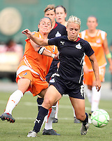 Lori Lindsey #6 of Washington Freedom is tackled by Julianne Sitch #38 of Sky Blue FC during a WPS match at RFK Stadium on May 23, 2009 in Washington D.C. Freedom won the match 2-1