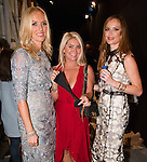 Designer Keren Craig (left) and Georgina Chapman (right) of Marchesa pose backstage with Jenny Shipley Buettner of Shibue Couture the official under garment of the show, after the Marchesa Spring 2017 collection fashion show in The Arc, Skylight at Moynihan Station on September 13, 2016 during New York Fashion Week Spring Summer 2016.