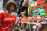 July 15, 2010 - Tokyo, Japan - A booth assistant introduces the 'Kinopio' game during the International Tokyo Toy Show 2010 at Tokyo Big Sight, Japan, on July 15, 2010.The toy fair, held from July 15 to July 18, attracts buyers and visitors by introducing the latest products presented by various toymakers from Japan and abroad.