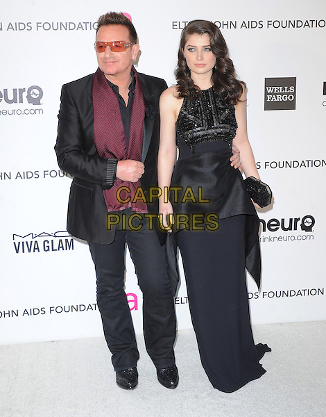 Bono of U2 (Paul David Hewson) & Eve Hewson.The 21st Annual Elton John AIDS Foundation Academy Awards Viewing Party held at The City of West Hollywood Park in West Hollywood, California, USA..February 24th, 2013.oscars full length scarf suit maroon dress father dad daughter family peplum red black sunglasses shades                                                    .CAP/DVS.©DVS/Capital Pictures.