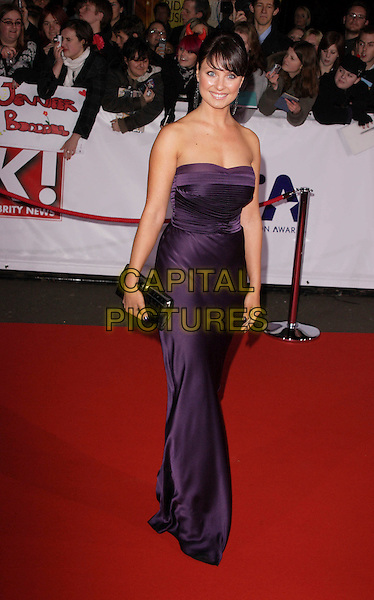 EMMA BARTON.The National Television Awards, Royal Albert Hall, London, England..October 31st, 2007.TV full length purple dress strapless satin clutch purse bag black.CAP/ROS.©Steve Ross/Capital Pictures