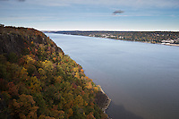 View northeast over the Hudson River with a view of fall foliage and the palisades cliffs as seen from Palisades Interstate Park, State Line Lookout, New Jersey.