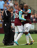 Andre Ayew of West Ham substituted by Arthur Masuaku of West Ham (C) during the Premier League match between West Ham United v Swansea City at the London Stadium, London, England, UK. Saturday 30 September 2017