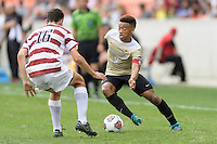 Houston, TX - Friday December 11, 2016: Jacori Hayes (8) of the Wake Forest Demon Deacons attempts to dribble the ball around Adam Mosharrafa (16) of the Stanford Cardinal at the NCAA Men's Soccer Finals at BBVA Compass Stadium in Houston Texas.