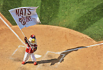 22 June 2014: Washington Nationals Mascot Screech waves a flag in victory over the visiting Atlanta Braves at Nationals Park in Washington, DC. The Nationals defeated the Braves 4-1 to split their 4-game series and take sole possession of first place in the NL East. Mandatory Credit: Ed Wolfstein Photo